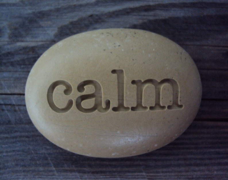 Engraved pebble with the word calm